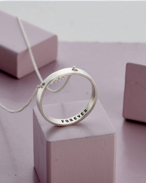 An image of Personalised Embossed Ring Pendant made by Nayab Jewelry which is made of Pure Sterling Silver.